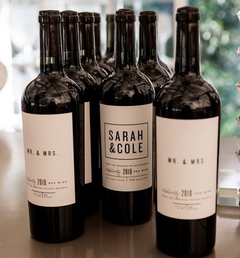 Newly Weds Foods Logo: Wine Bottles Labeled With Personalized Label For Newlyweds