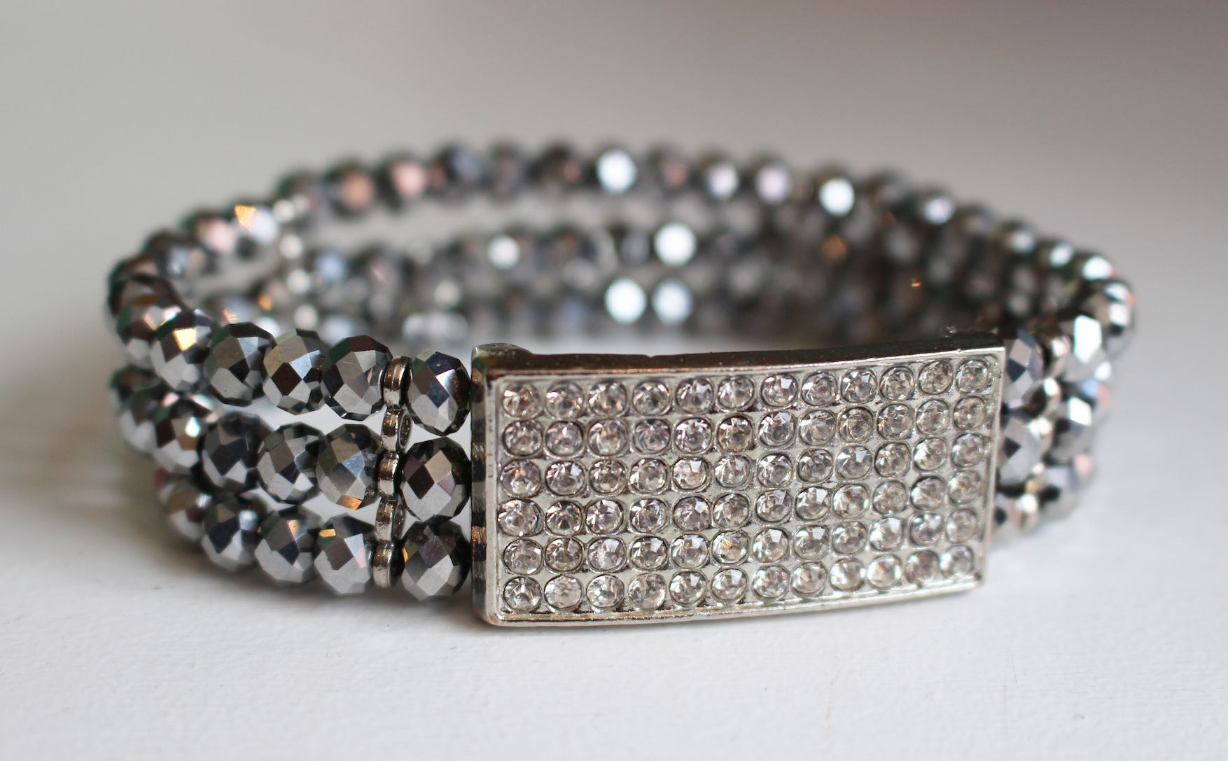 A glamorous bracelet featuring striking beads and a rhinestone, covered bar. ($34)