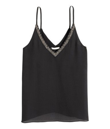 Black. Camisole top in airy woven fabric with beaded embroidery at upper edge. V-neck at front and back, narrow shoulder straps, and horizontal strap at