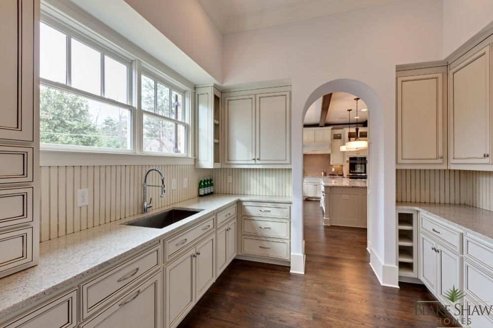 A Close Up View Of The Prep Kitchen With Custom Cabinets.
