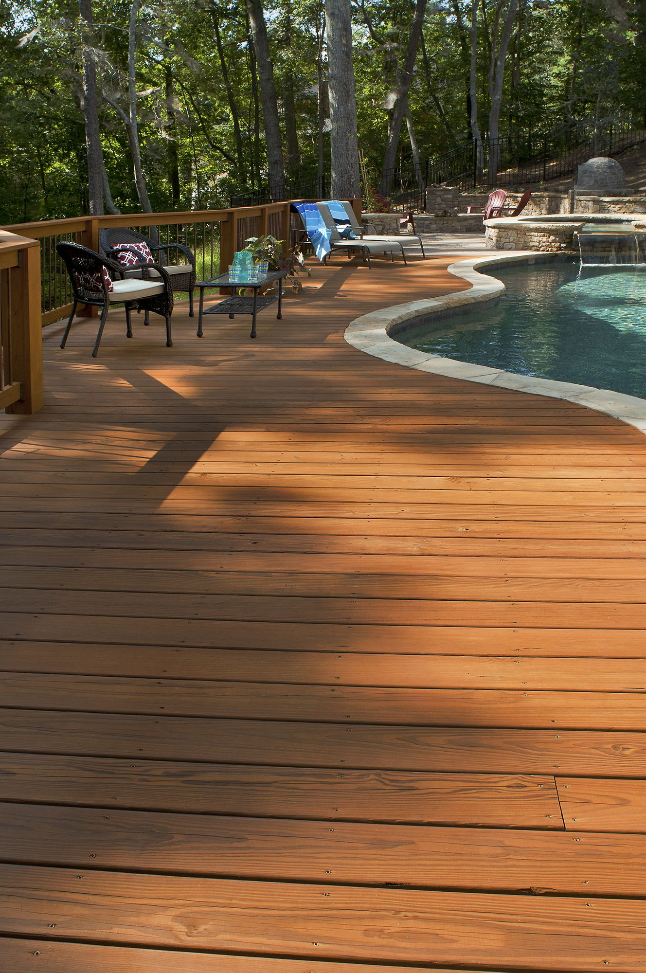Wood Deck Adjoining An Inground Pool Designed And Built By