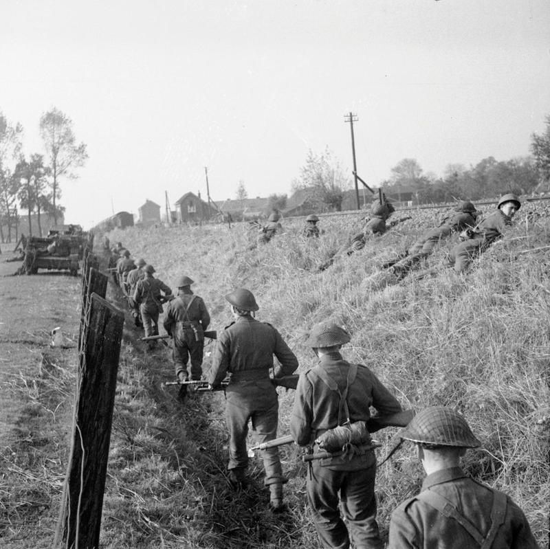 OCT 27 1944 Wounded and on the run in occupied Holland Infantry of 4th Welch Regiment, 53rd Division, advance along a railway embankment during the capture of Hertogenbosch 25 October 1944.