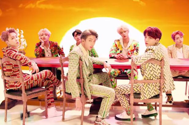 Bts Takes Pride In Their Sense Of Self In Vibrant Video For Idol Watch Music Videos Idol Bts