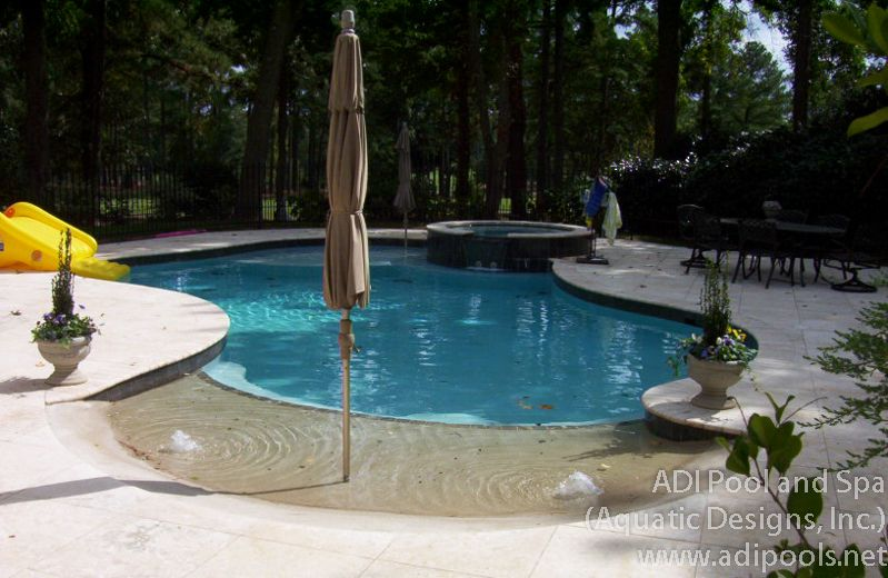 Beach entry swimming pool with umbrella anchor spa and for Pool design raleigh nc