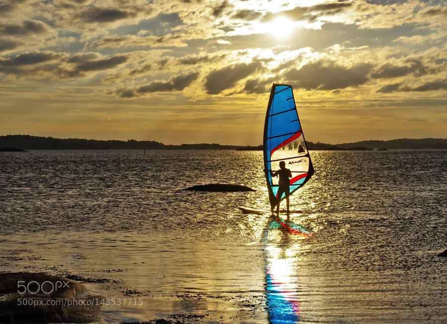 Blue sail in the sunset