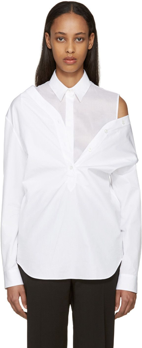 599685fa8b8 Layered off-the-shoulder poplin shirt in white. Y-neck closure with  four-button placket at front and back. Single-button barrel cuffs.