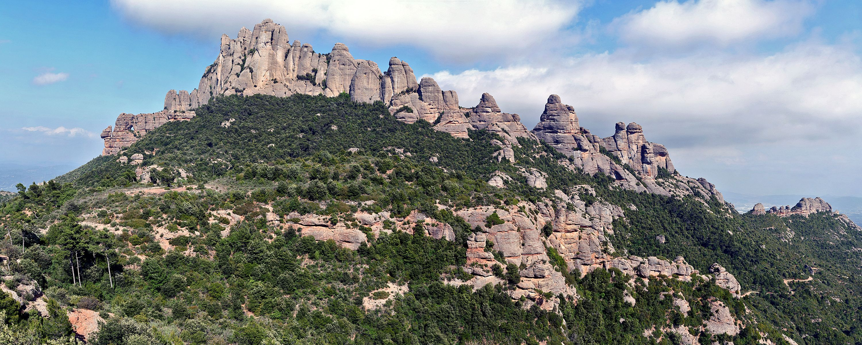 Sun in the mountains of Montserrat, Catalonia, (Panoramic view).  24 photos with a Canon EOS 1000D and a Canon 50 mm 1:1.8 II.  Photo Details: ISO 100 - F8 - 1/250