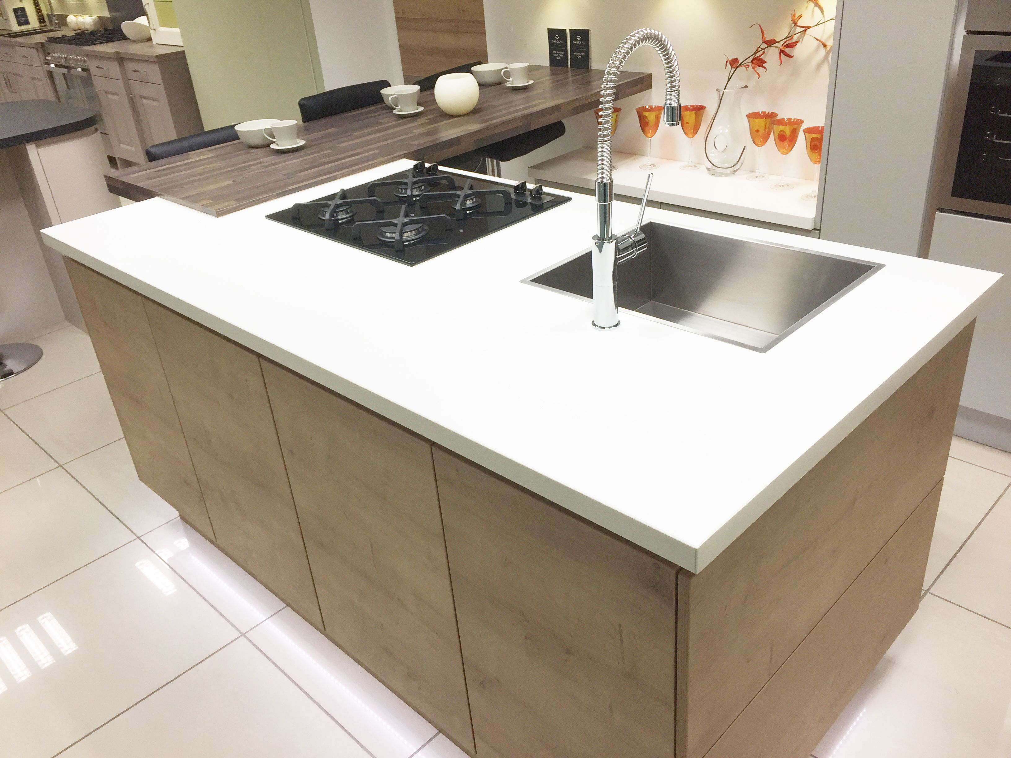 Modern kitchen island with hob sink and breakfast bar area