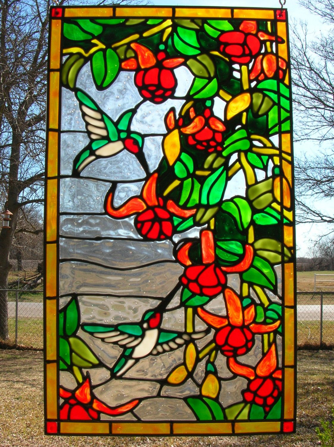 Hummingbirds with red tropical flowers stained by for Window design art