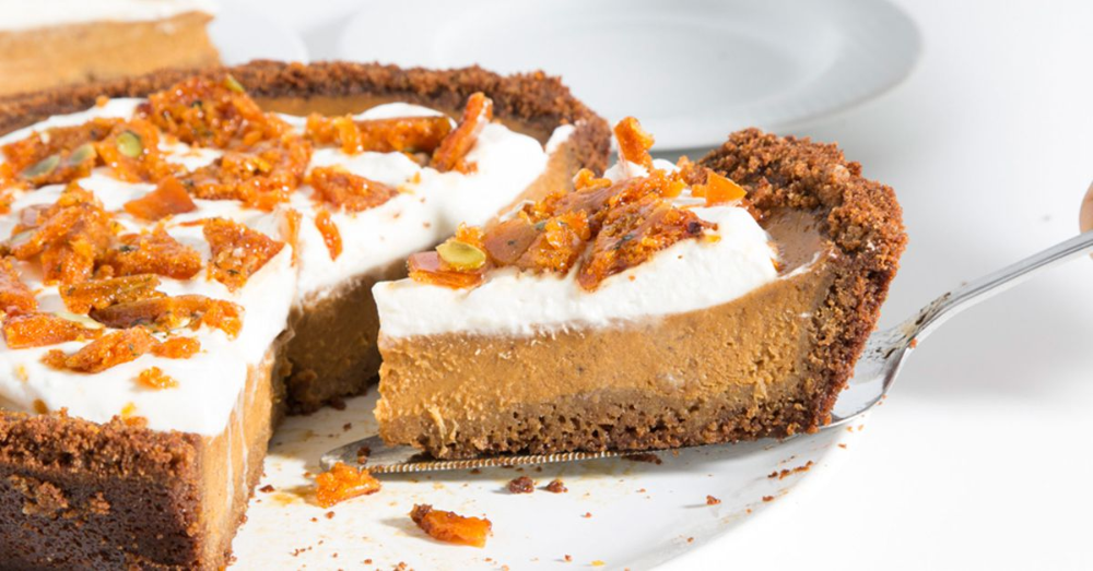 Pumpkin Pie with Graham Cracker Crust and Pepita–Sage Brittle Recipe #homemadegrahamcrackercrust A sprinkle of bittersweet caramel brittle adds a welcome crunch to this perennial favorite, made even more special with a homemade graham cracker crust. #homemadegrahamcrackercrust