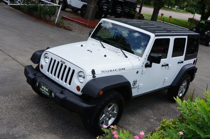 2011 White Clearcoat Jeep Wrangler Unlimited 4WD 4dr Rubicon   Rubicon... The Off-Road Ready!! Rock-Trac four wheel drive with 4:1 transfer case, front and rear next generation DANA 44 axles with electric lockers!! http://www.selectjeeps.com/inventory/view/8504675/2011-Jeep-Wrangler-Unlimited-4WD-4dr-Rubicon-League-City-TX