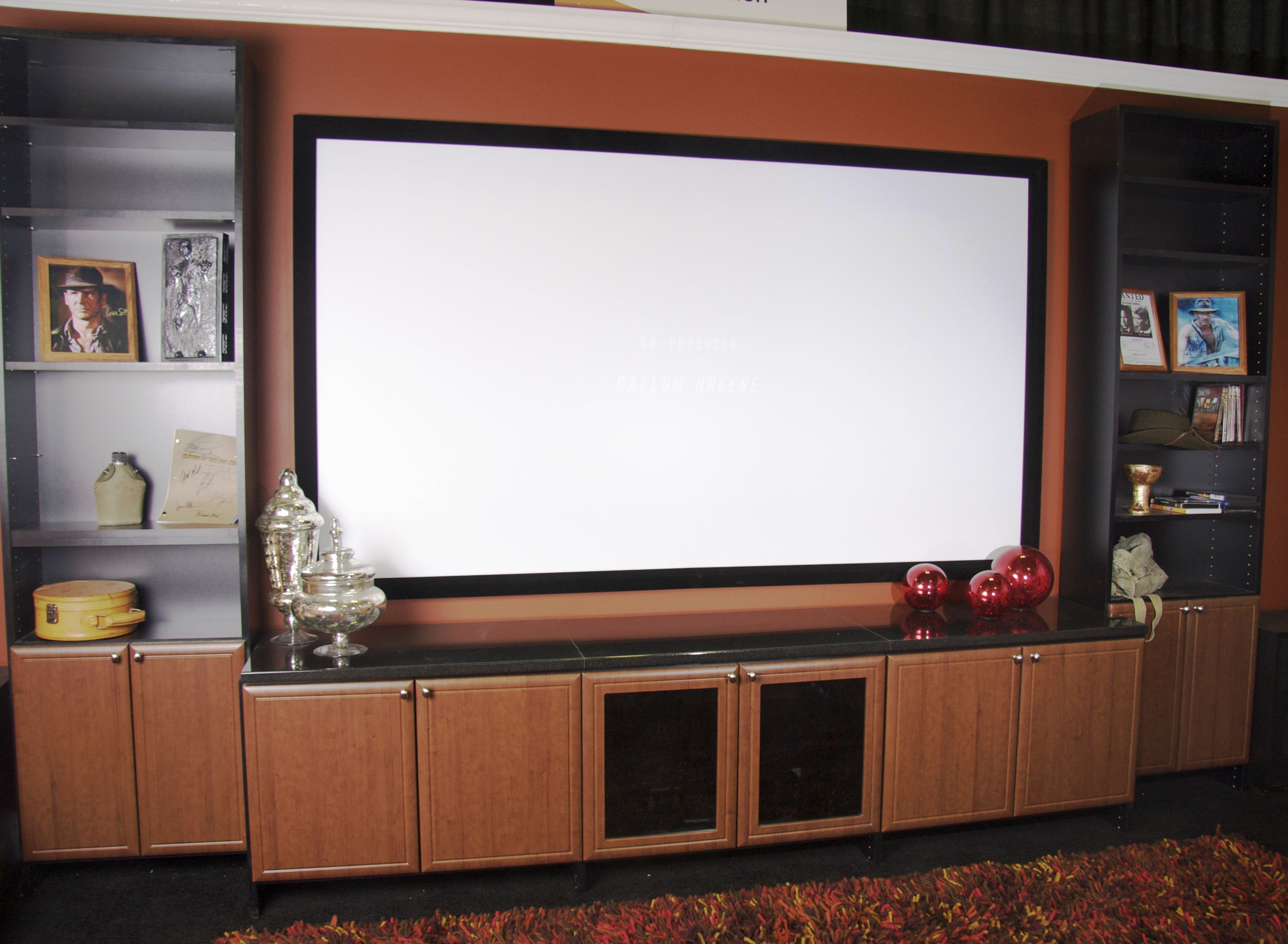 This wall unit provides open and enclosed storage surrounding a ...