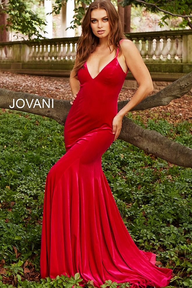 7d2270c6f9 Floor length form fitting hot pin velvet prom dress with sweeping train  features sleeveless bodice with spaghetti straps v neck and low back.   Jovani ...