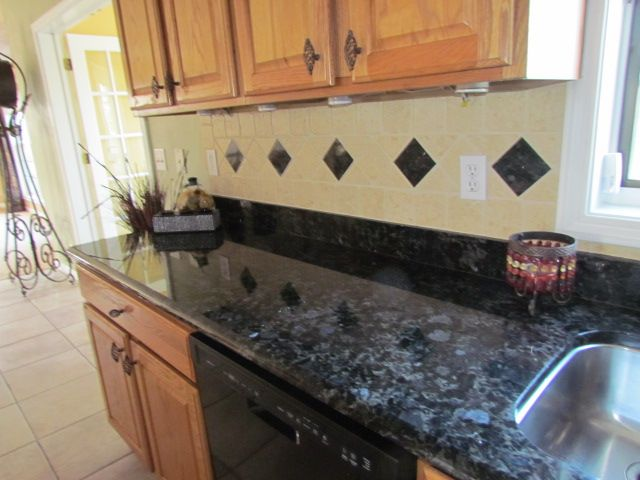 Blue volga granite from ukraine tumbled marble backsplash for Blue countertop kitchen ideas