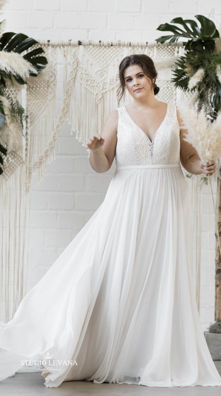 Soft and bohemian look in a custom plus size wedding dress