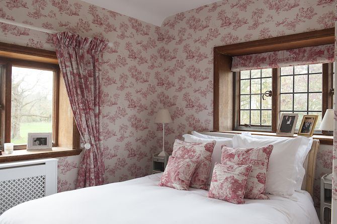 The Spare Room Features Matching Wallpaper Curtains And Cushion