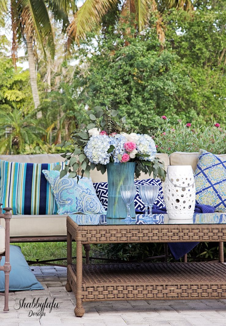 Spring Patio Styling With Colorful Outdoor Pillows, Candles, Lanterns And  Flowers.