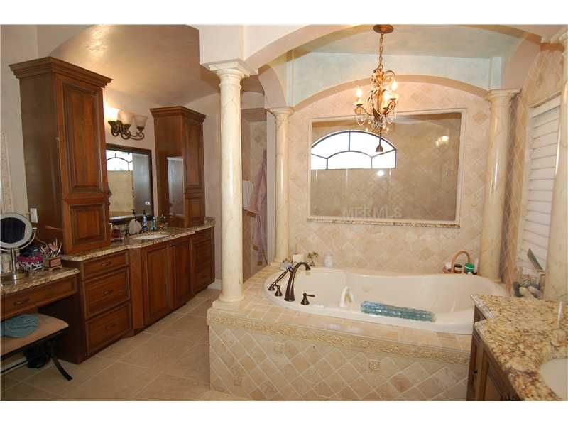 Luxurious Master Bath Featuring Dual Vanities Jetted Tub