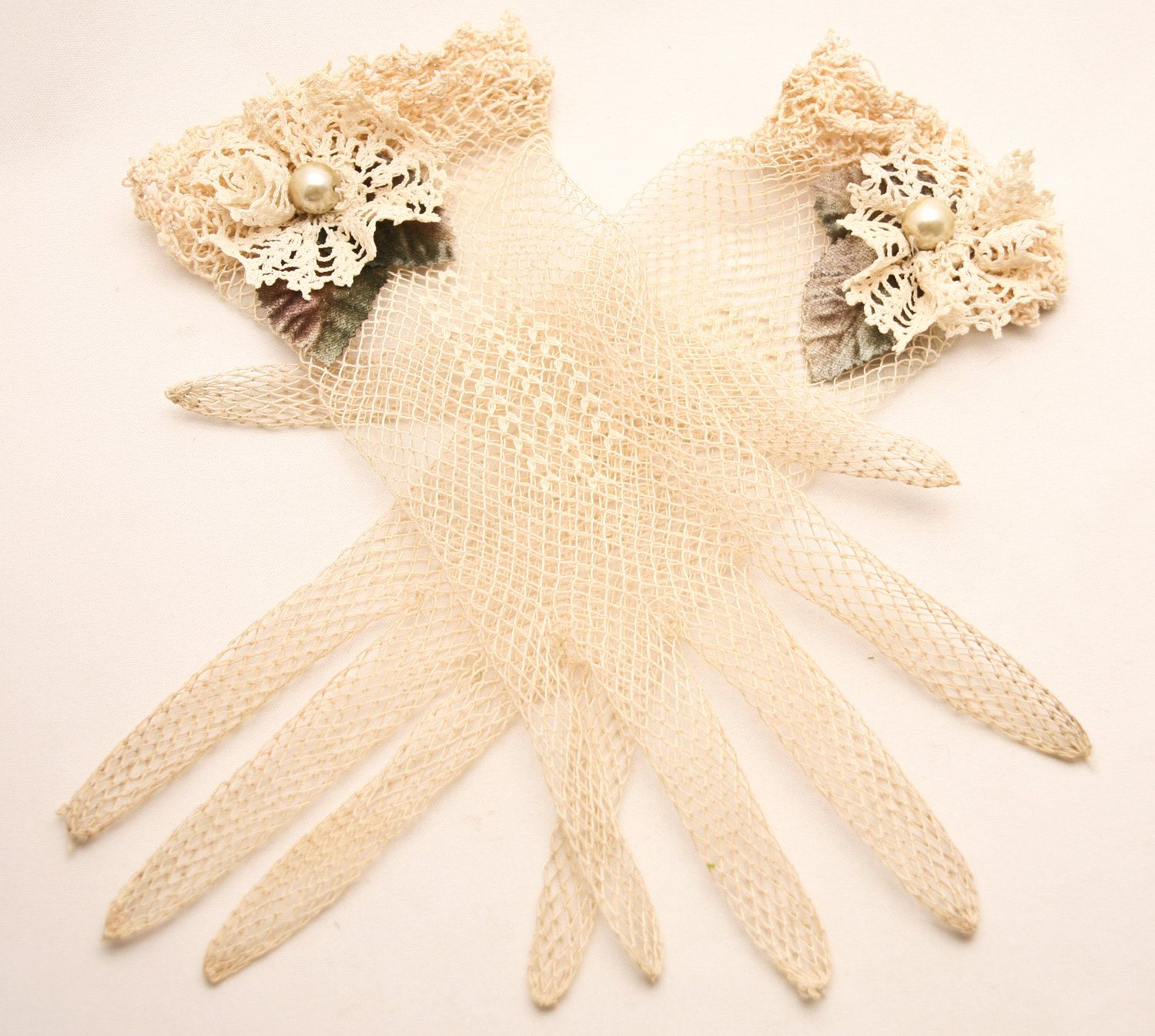 Vintage lace gloves with vintage lace flowers and leaves added. $55.00, via Etsy.