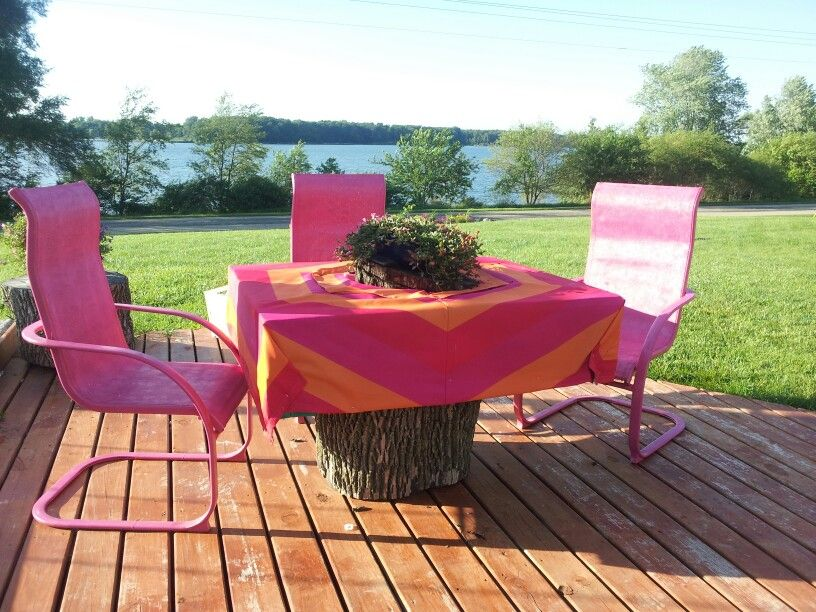 Repurpose Patio table made out of 2 wood pallets, log and broken umbrella topper.