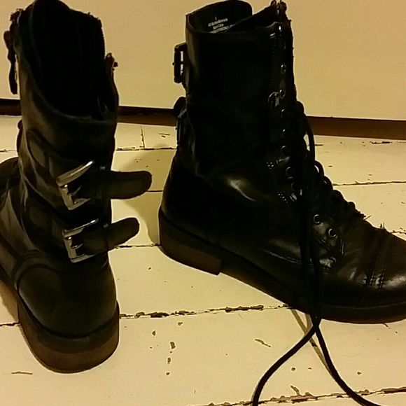 Black combat boots Black combat boots lace - up but with easy on zipper! Super comfy now that I've broken them in for you haha!  Only sign of wear is tiny scoff on right toe (shoe on left in last picture )  Buckle details in the back on both shoes are super cool! target Shoes