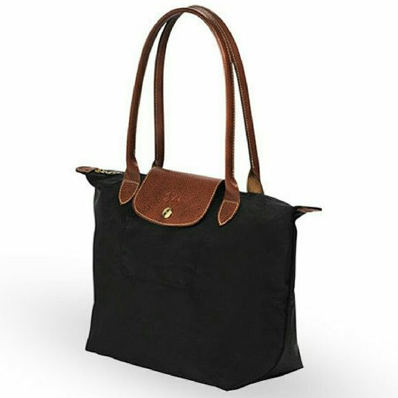 2f36c3754bde Longchamp 1948 tote Longchamp 1948 black tote with brown leather closure  and handles. Very well taken care of