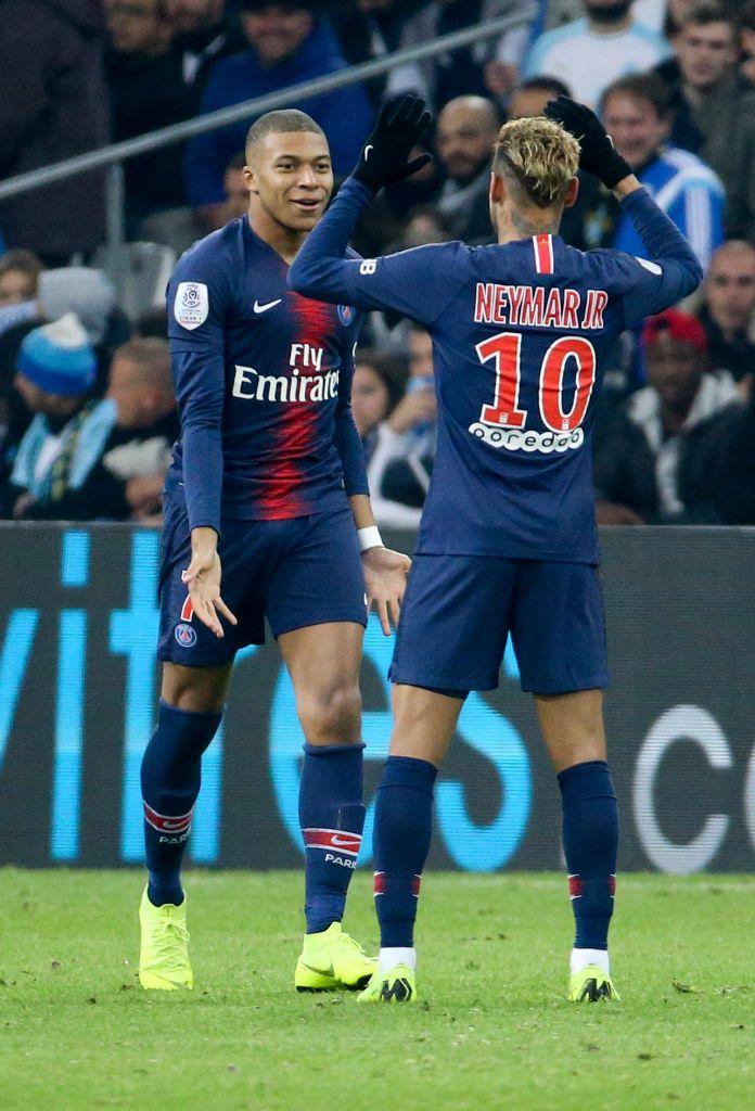 Kylian Mbappe of PSG celebrates his goal with Neymar Jr