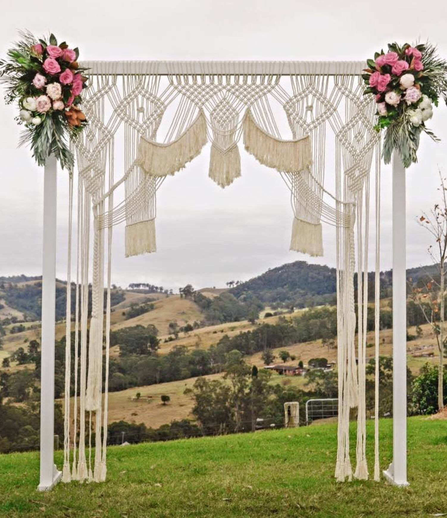 A macrame wedding backdrop is the BEST way to reuse decor