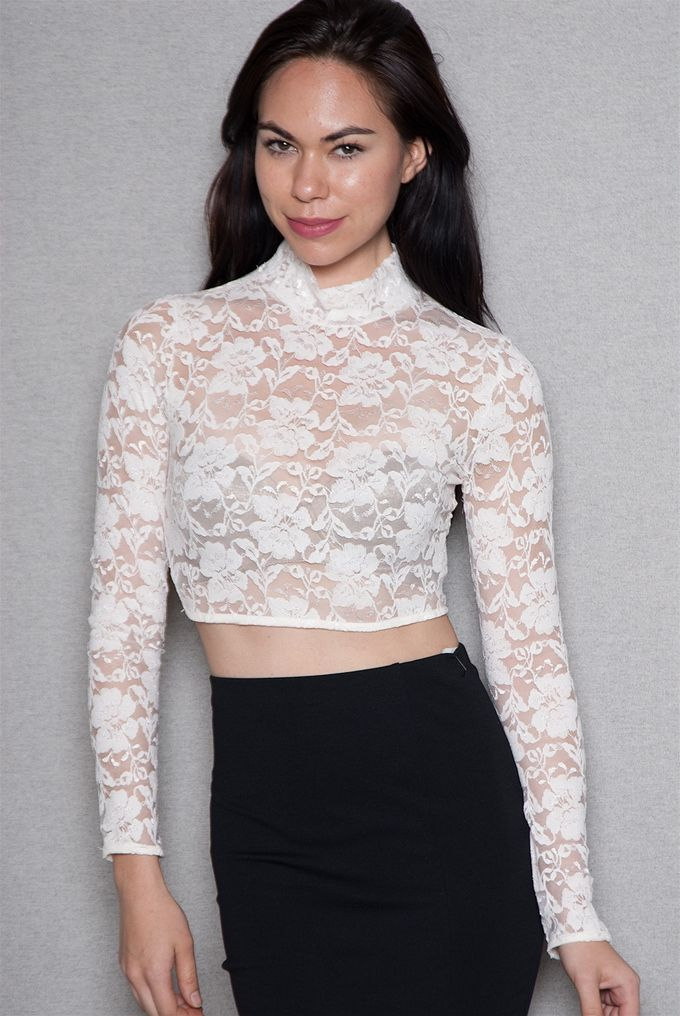94d298a0a00 Embrace lace in this unexpected sheer ivory Victorian-inspired high-neck  crop top Featuring