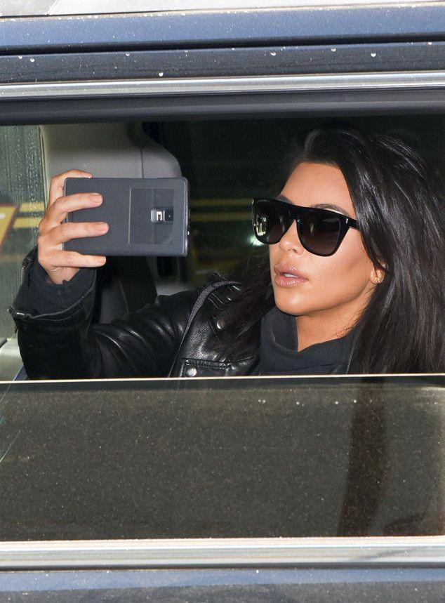 Kim Kardashian In YSL Sunglasses http://www.framesdirect.com/framesfp/Yves_Saint_Laurent-pakjrft/lb.html photo by:Vantagenews/AKM-GSI