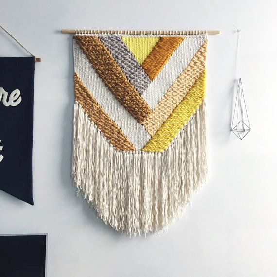 This is a hand woven wall hanging in a spring-inspired palette of golden yellows. The dowel is 24 inches wide, and the whole weaving measures 24x28 inches, including the fringe.  It makes a beautiful gift for a housewarming, birthday, or wedding.  This weaving is made to order (~2