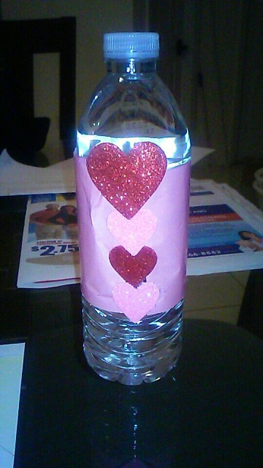 Decorate a water bottle with wrapping paper and glitered hearts for a cute but simple beverage on V-day.