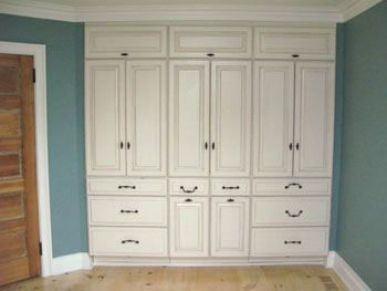 Enhance A Bedroom By Creating Custom Built In Closets From Stock Cabinets.