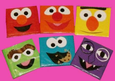 Sesame Street wallets made out of duct tape being sold on Etsy.com--How cute are these?!    I want one.