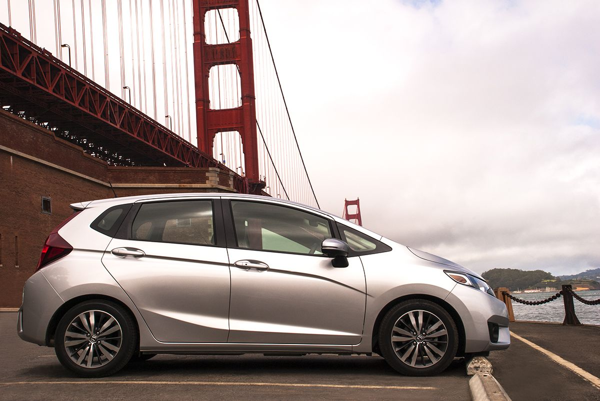 Driving A Honda Fit Makes Even The Cloudiest Days Feel Sunny Take Advantage Of The Day And Go See Something You Ve Never Seen Befor Honda Fit Honda Honda Jazz