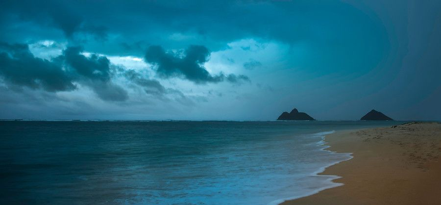I barely got this photo in time. I could see the storm coming across the beach towards us. About 60 seconds after I took this photo, you couldn't even see the islands. The worst part wasn't getting soaked — it was having to run back to the car in the torrential downfall with all my equipment. - Oahu, Hawaii - Photo from #treyratcliff Trey Ratcliff at http://www.StuckInCustoms.com