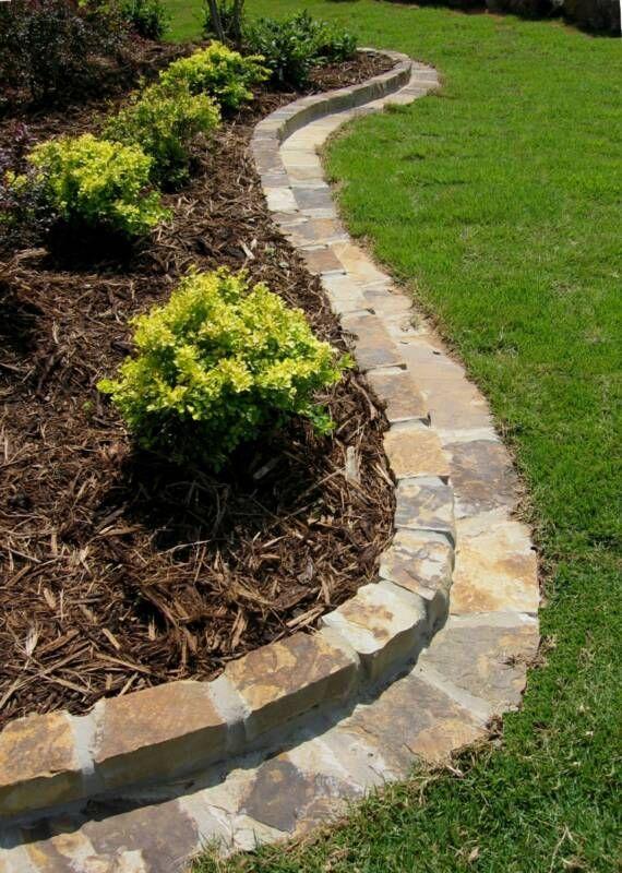 Bury stones to make a mow strip szukaj w google bruki for Making a rock garden border