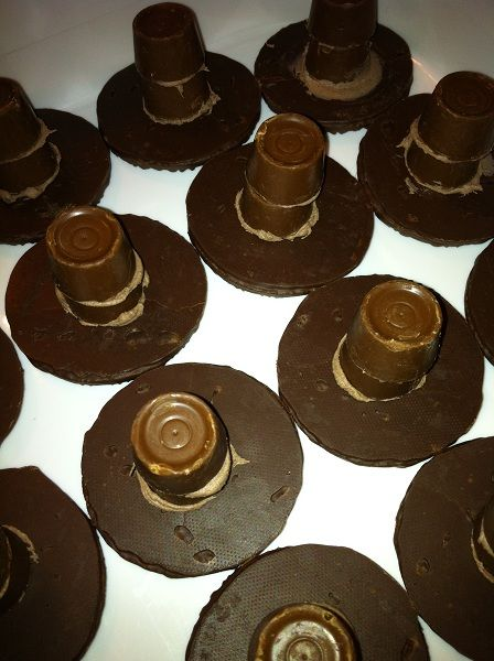 Lincoln's Hat – Quick & Easy President's Day Treats using fudge striped cookies (upside down), rolos and chocolate frosting