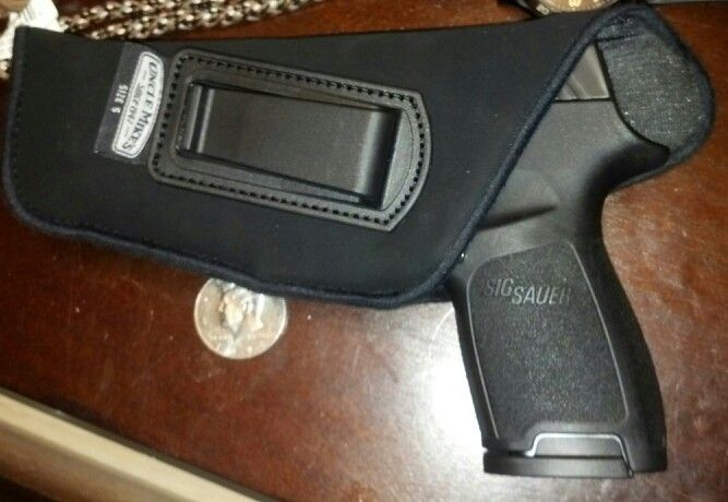 Sig p320c in its new EDC/ IWB holster, Uncle Mike's size 5