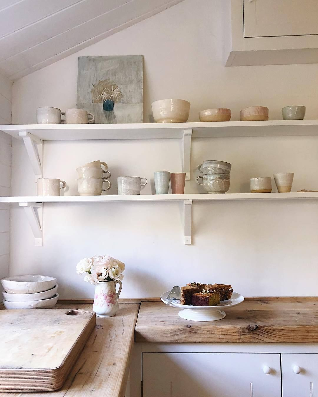 Simple White Kitchen With Wooden Worktop And Open Shelving