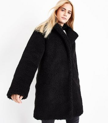 3184c4a2566 #Black Teddy Faux Fur Coat New Look 5447753 #Wrap up warm this season in  this teddy faux fur coat. Layer over any outfit for an instant style lift.