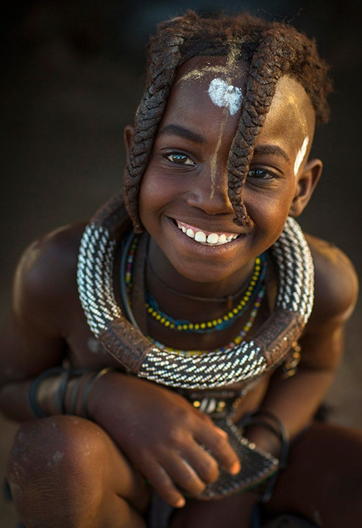 africa | young himba girl, with traditional hairstyle. epupa