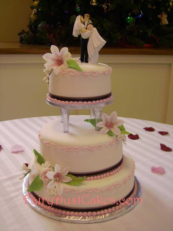 3 tier wedding cake with pink accents and clear columns from Fairy ...