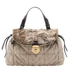 BAG SNOB -  is made buy soft hair of certain animals skin. It is made internationally and it looks like the same of Hermes bag.     https://www.google.com.ph