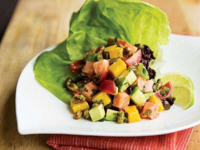 Salmon Ceviche Lettuce Cups (perfect summer appy!): Asian meets Latin American in this incarnation of ceviche. Crunchy edamame beans provide a wonderful textural contrast, while placing all the contents in lettuce leaves makes each bite taste extra fresh. #wildsalmon #summer #recipe