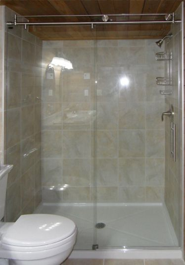 This roller door makes this small shower look enormous by not taking ...
