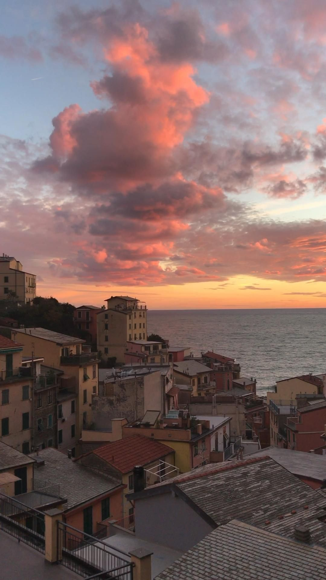 A beautiful sunset in the village of Riomaggiore in Cinque Terre, Italy. Find also 34 images to inspire you to visit Cinque Terre, Italy. #cinqueterre #riomaggiore #italytravel #italyvacation