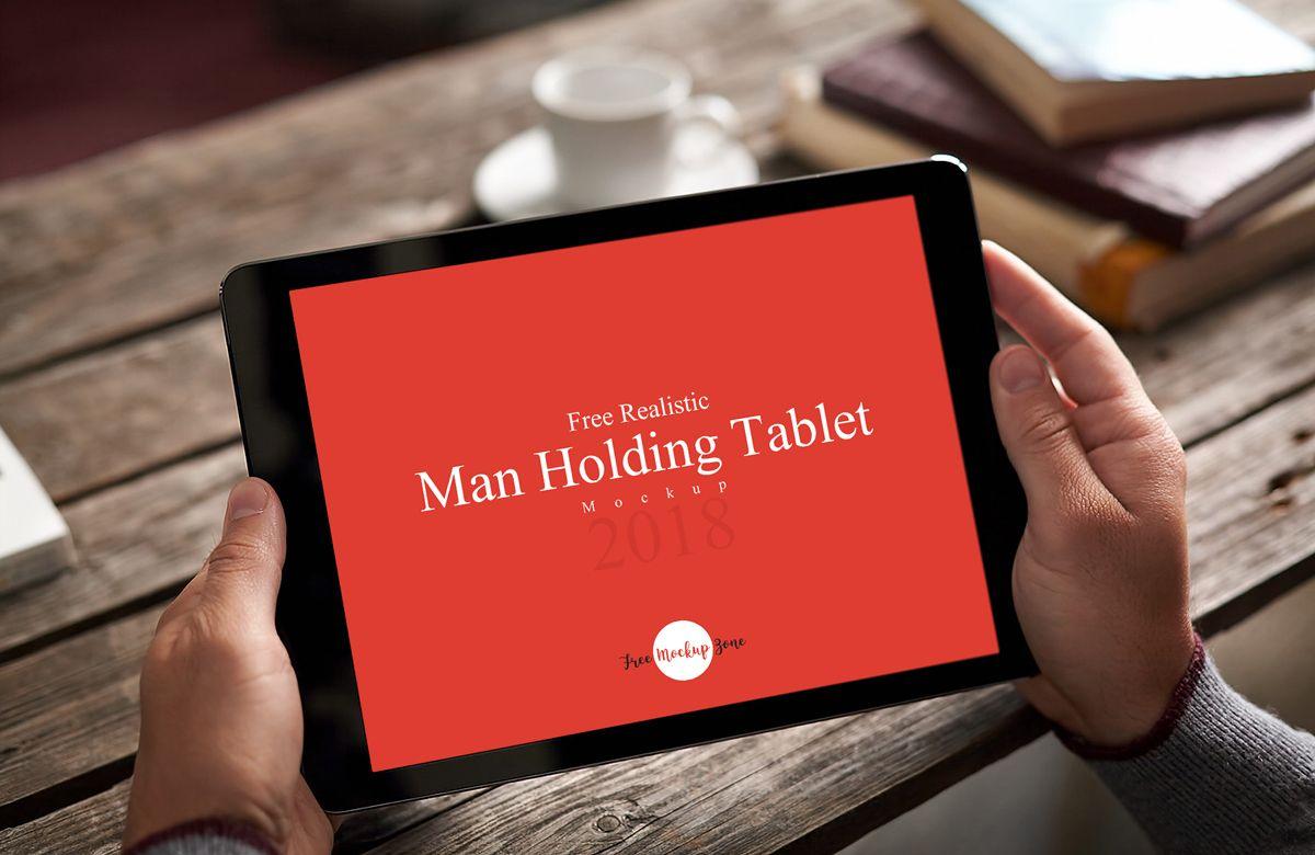 Free Realistic Man Holding Tablet Mockup Mockup Free Tablet