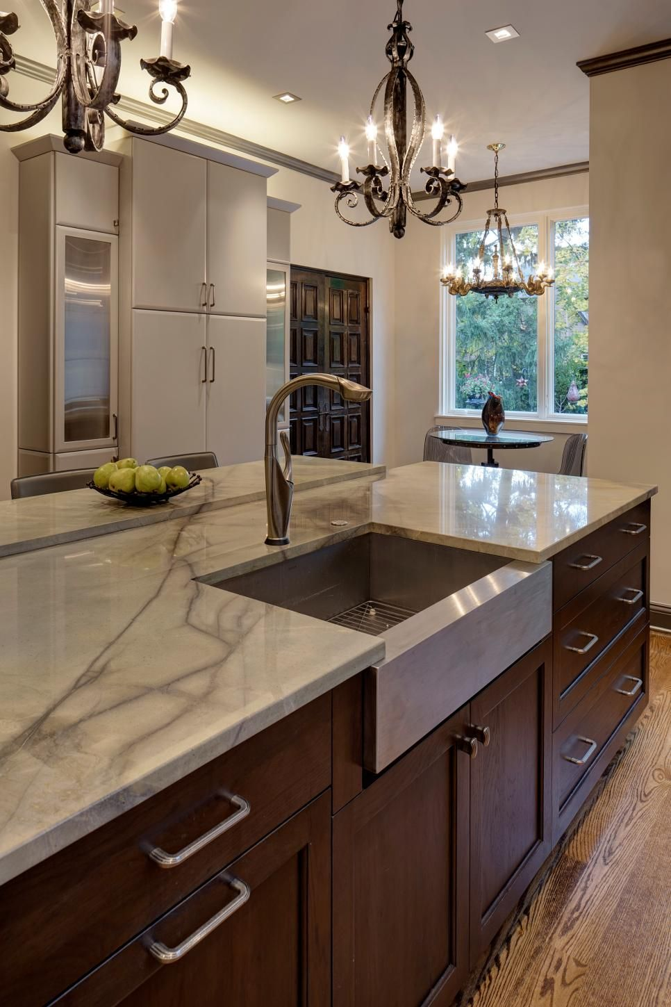 This Large Kitchen Island Features A Quartz Countertop Hickory