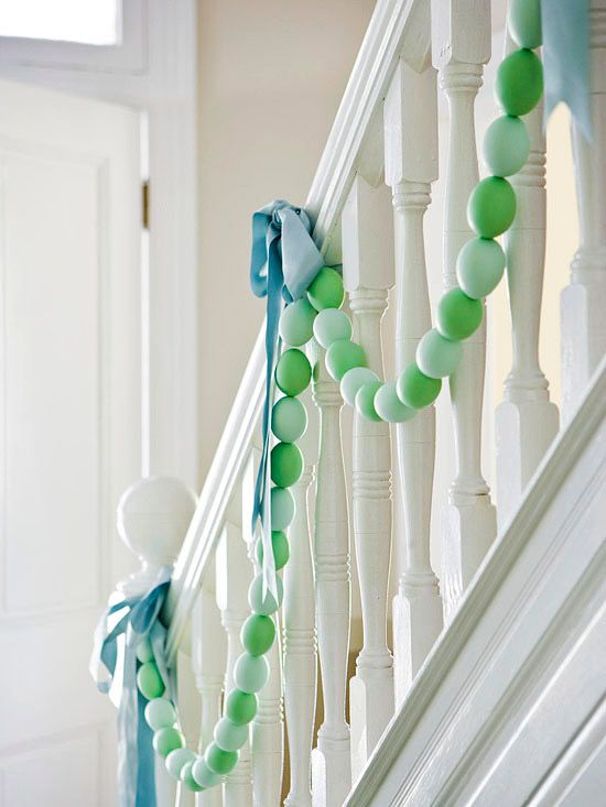 Decorate a staircase, mantel or table with an Easter egg garland. How-To: http://www.bhg.com/holidays/easter/decorating/decorate-with-easter-eggs/#page=7